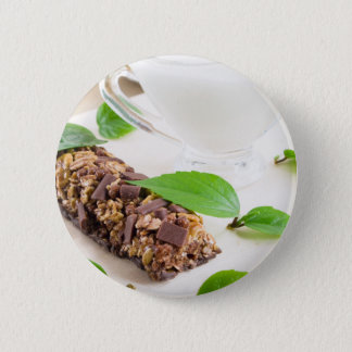 Chocolate bar with a cereal and milk for breakfast pinback button