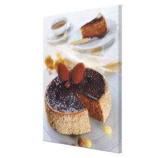 Chocolate cake on plate, close-up canvas print