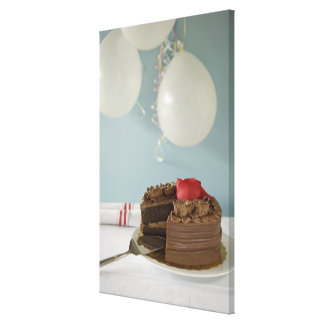 Chocolate cake with missing slice on table, canvas print