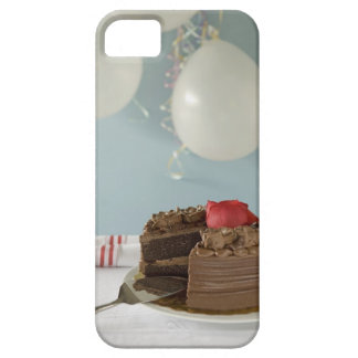 Chocolate cake with missing slice on table, iPhone 5 case