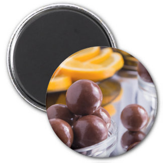 Chocolate candies in a small glass bowl close-up magnet