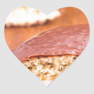Chocolate cookies with milk souffle on a brown heart sticker