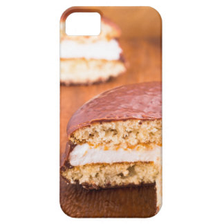 Chocolate cookies with milk souffle on a brown iPhone SE/5/5s case