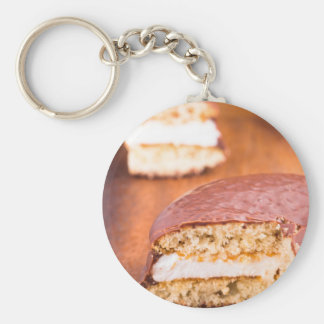 Chocolate cookies with milk souffle on a brown keychain