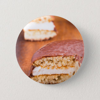 Chocolate cookies with milk souffle on a brown pinback button