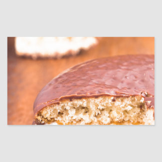 Chocolate cookies with milk souffle on a brown rectangular sticker