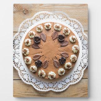 Chocolate cream pie on rustic wood cake top plaque