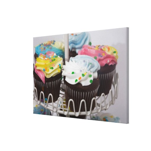 Chocolate cupcakes on a cake stand 2 stretched canvas prints