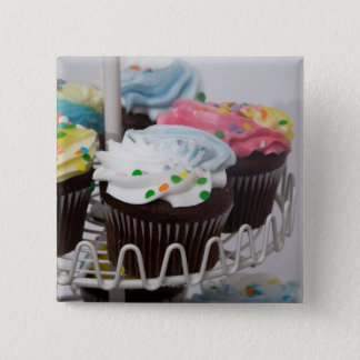 Chocolate cupcakes on a cake stand 2 pinback button