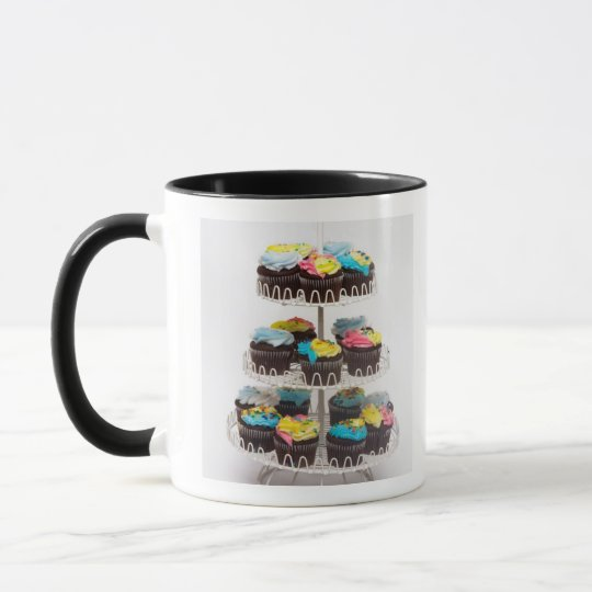 Chocolate cupcakes on a cake stand mug