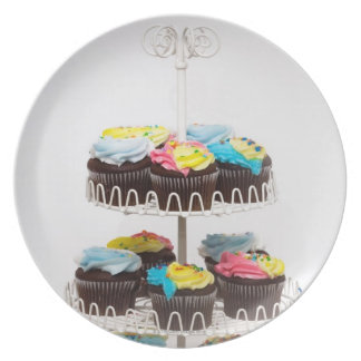Chocolate cupcakes on a cake stand plates