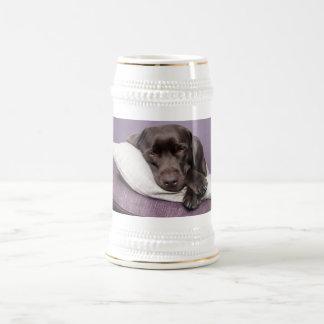 Chocolate labrador retriever dog sleepy on pillows beer stein