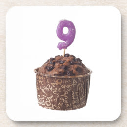 Chocolate muffin with birthday candle for nine beverage coaster