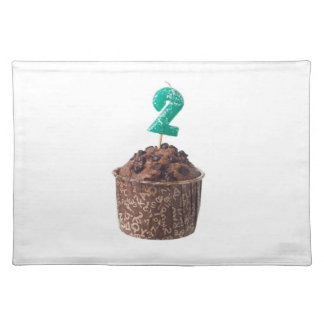Chocolate muffin with birthday candle for two year cloth placemat