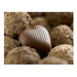 chocolate nestled amongst other chocolates postcard
