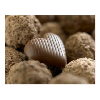 chocolate nestled amongst other chocolates postcards
