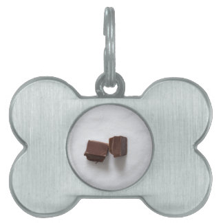 Chocolate with sugar as a background pet name tag