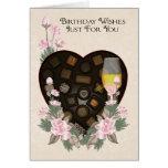 Chocolates vino y tarjeta de felicitación del cump