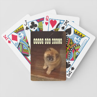 Chow puppy playing cards