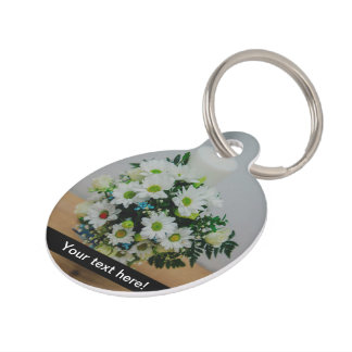 Christening candle with white flowers pet ID tags
