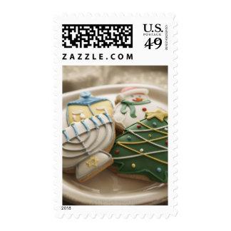 Christmas and Hanukkah cookies on plate, Stamp