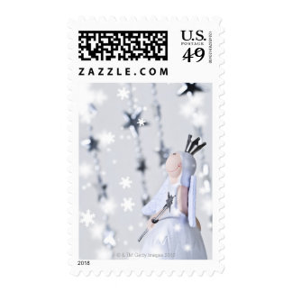 Christmas angel ornament with dangling silver postage stamps