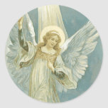 """Christmas Angel Sticker<br><div class=""""desc"""">Beautiful vintage image of angel in a beam of light. Colors are white and turquoise and tan.</div>"""