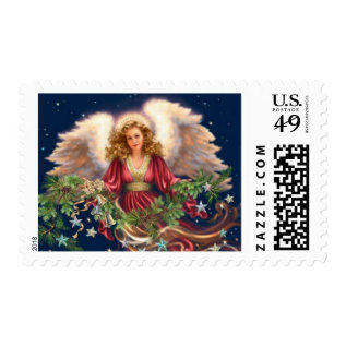 Christmas Angel With Greenery Postage at Zazzle