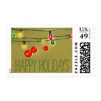Christmas balls hanging on lights stamp