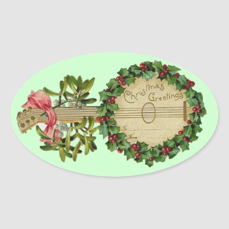 CHRISTMAS BANJO WITH MISTLETOES AND HOLLY BERRIES OVAL STICKER