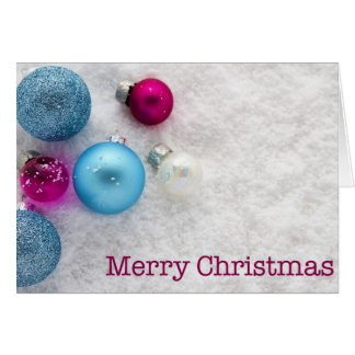 Christmas baubles on snow greeting card