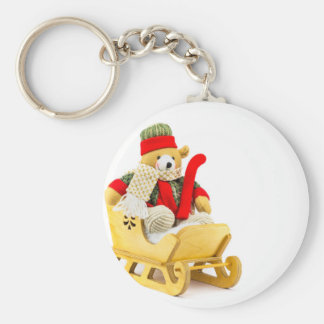 Christmas bear in wooden sleigh on white keychain