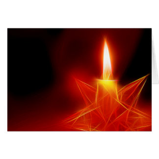 Christmas card candle burning in glass star