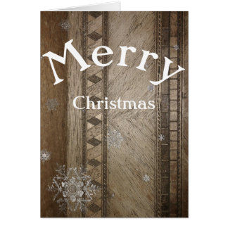 Christmas card with snowflake on woodwork