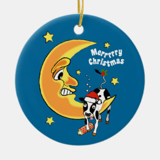 Christmas cow slumped over the moon ceramic ornament