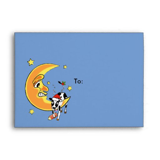 Christmas cow slumped over the moon envelope