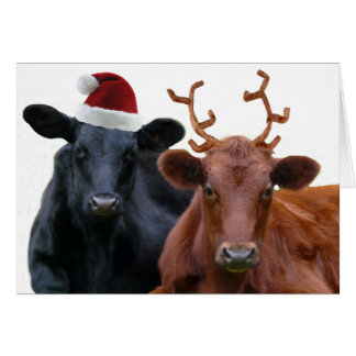 Christmas Cows in Santa Hat and Antlers Greeting Card