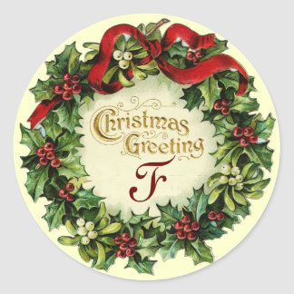 CHRISTMAS CROWN WITH MISTLETOES AND HOLLY BERRIES CLASSIC ROUND STICKER