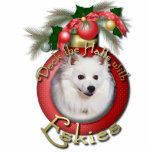 "Christmas - Deck the Halls - Eskies Cutout<br><div class=""desc"">Celebrate the Christmas Season with this Deck the Halls design using this American Eskimo Dog! Dog Portrait is framed within a Christmas Ornament, embellished with evergreen branches and more ornaments. This design is available in 100 dog breeds. If you don&#39;t see your favorite breed or if you&#39;d like to see...</div>"