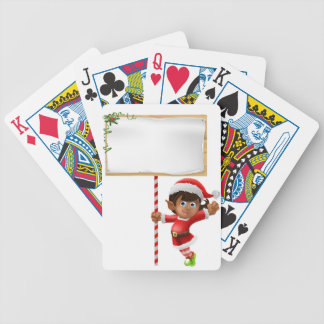 Christmas elf holding a sign bicycle poker cards