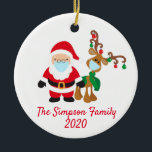 """Christmas Face Mask Santa Reindeer 2020 Custom Ceramic Ornament<br><div class=""""desc"""">This design was created though digital art. It may be personalized in the area provided or customizing by changing the photo or added your own words. Contact me at colorflowcreations@gmail.com if you with to have this design on another product. Purchase my original abstract acrylic painting for sale at www.etsy.com/shop/colorflowart. See...</div>"""