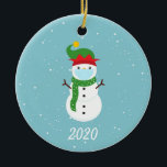 """Christmas Face Mask Snowman 2020 Ceramic Ornament<br><div class=""""desc"""">This design was created though digital art. It may be personalized in the area provided or customizing by changing the photo or added your own words. Contact me at colorflowcreations@gmail.com if you with to have this design on another product. Purchase my original abstract acrylic painting for sale at www.etsy.com/shop/colorflowart. See...</div>"""