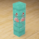 """Christmas Flamingo Stripe wine gift box<br><div class=""""desc"""">Stylish design with a retro touch featuring a festive pink flamingos wearing red Santa hats, stars and palm trees decorated with baubles set against a striped aqua background. A customizable design for you to personalise with your own text, images and ideas. An original digital art image created by Quirky Chic....</div>"""