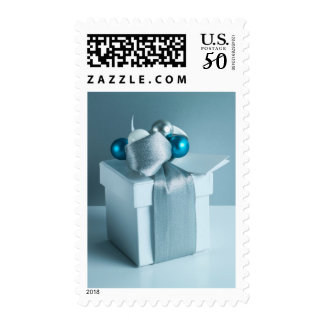 Christmas gift with silver ribbon and wrapping postage