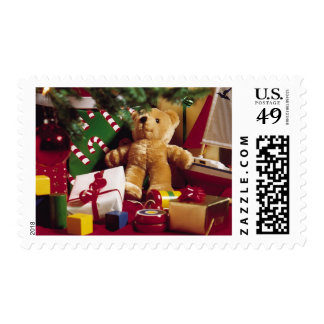 Christmas gifts and toys around the tree postage
