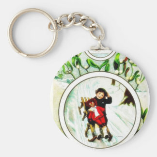 Christmas greeting with a boy holds toy in hand key chains