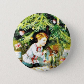 Christmas greeting with a boy playing under the de pinback button