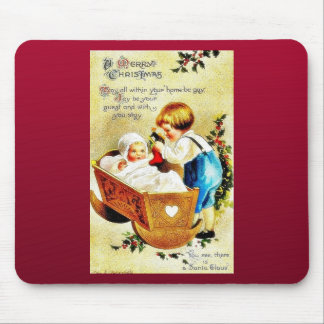 Christmas greeting with a child in a caddle and th mouse pad