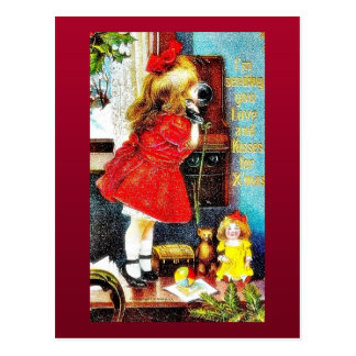 Christmas greeting with a girl making a phone call postcard