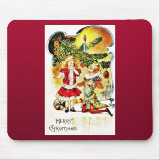 Christmas greeting with a joker kneeling down and mouse pad
